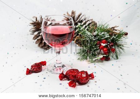 Luxury Wine And Chocolates In A Snowy White Christmas Scene.