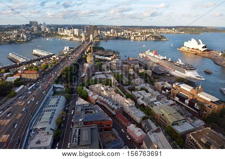 SYDNEY AUS - OCT 20 2016:Aerial urban landscape view of Sydney Harbour with Sydney Harbour Bridge the Opera House Circular Quay and The Rocks with North Sydney in the background at sunset in New South Wales Australia.