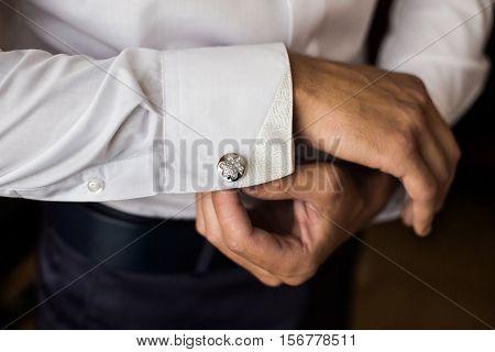 men wear a shirt and cufflinks correct clothes dressing