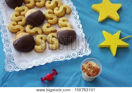 Birthday party decorated table with a plate of cookies and decorations
