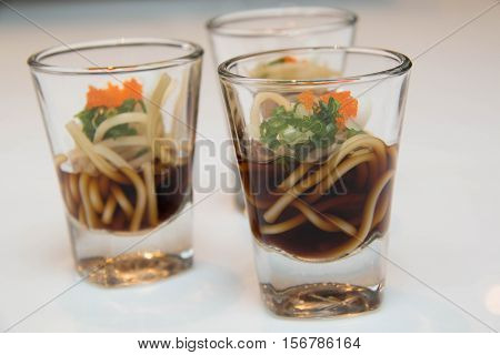 A background Noodle soup in mini glass