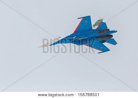 Omsk, Russia - March 19, 2016: Fighter Sukhoi Su-27 in the airshow Russian Knights.