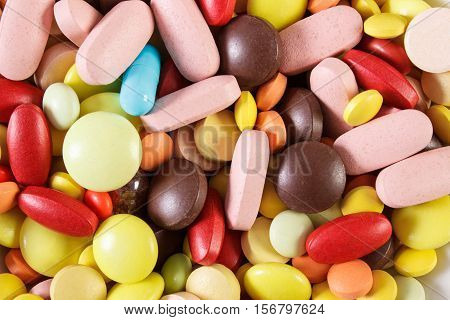 Colorful Medical Pills And Capsules As Background, Health Care Concept
