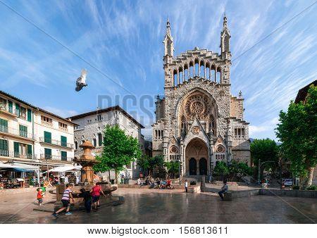 Soller Mallorca Spain - May 26 2016: Panoramic view of a town center of Soller with Sant Bartomeu Church on Placa de sa Constitucio Majorca.