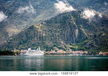 Kotor, Montenegro- October 21, 2016: Cruiser at port of Kotor in the early morning autumn