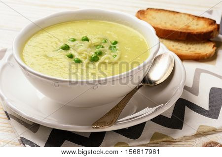 Vegetarian cream soup with leek, potatoes and green pea.
