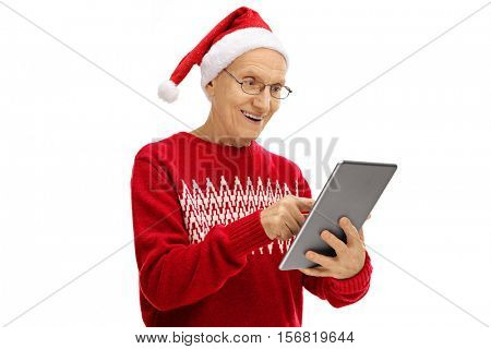 Senior with a Christmas hat looking at a tablet isolated on white background