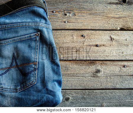 Neatly Folded Jeans On Wooden Background. Clothing, Fashion, Style, Lifestyle