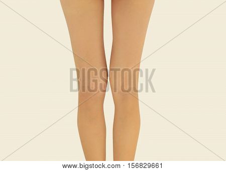 Beautiful slender female legs rear view. Prevention of varicose veins