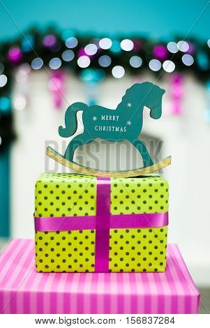 Christmas horse on the background of the fireplace with a garland