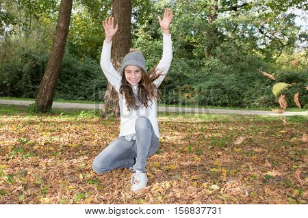 Girl Raises Hands To Sky In Hand, And Happy Autumn