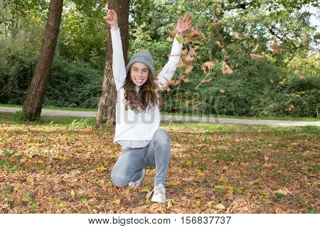 Girl Raises Hands To Sky In Hand, In The Forest