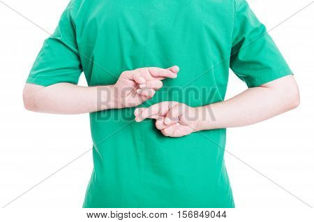 Medical Doctor Crossing Fingers Behind Back