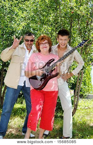 Family On The Nature In The Summer With An Electroguitar