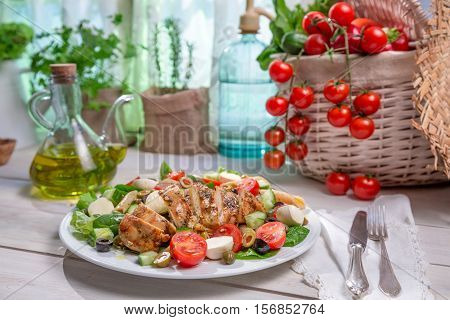 Salad With Chicken Cooked In A Sunny Kitchen