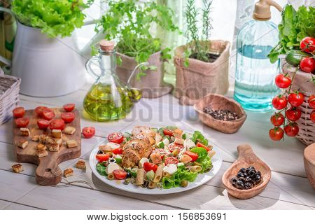 Enjoy Your Spring Salad With Salmon On Old Wooden Table