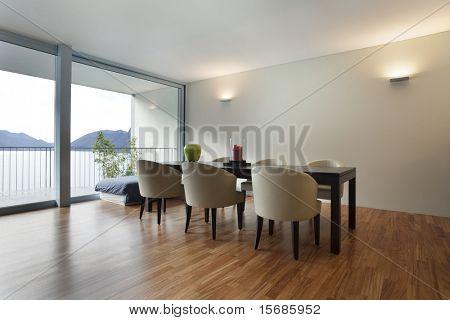 Vista interior do apartamento, mesa de jantar