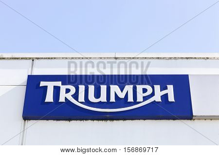Lyon, France - July 3, 2016: Triumph logo on a wall. Triumph Motorcycles is the largest British motorcycle manufacturer