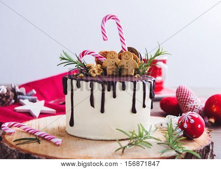 Homemade Christmas cake on a rustic wood stand and festive decoration