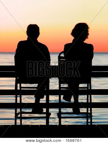 Retired Couple Watches The Sunset