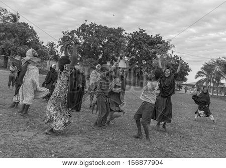 ZANZIBAR, TANZANIYA- JULY 16: african playing children with hands upon July 16, 2016 in Zanzibar.