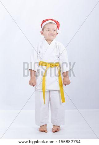 Sportsman in karategi and cap of Santa Claus