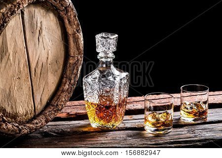 Two Glasses Of Aged Whisky And Old Barrel
