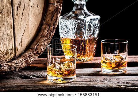 Two Glasses Of Good Whisky With Ice