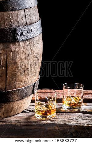 Two Glasses Of Aged Scotch On Black Background
