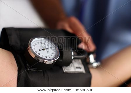 Medical worker checking blood pressure