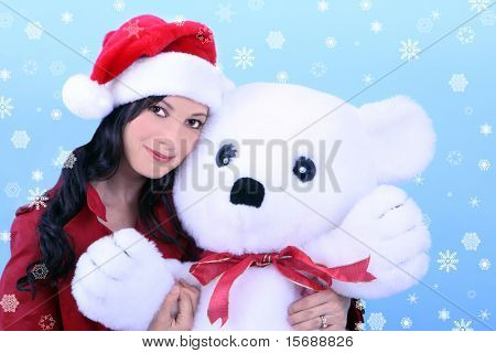 A young woman holding a stuffed bear, surrounded by snowflakes