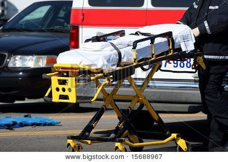 Emergency worker moving stretcher