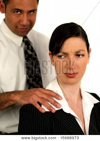Businessman sexually harassing female coworker