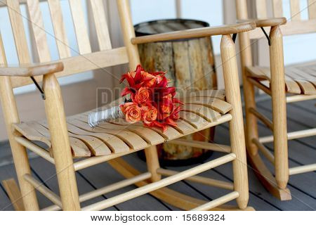 Vibrant autumn bouquet on old rocking chair
