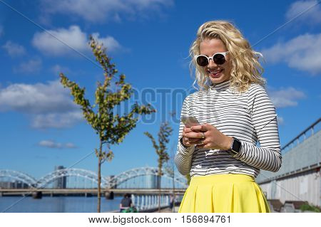 Stylish woman chatting on her smart phone