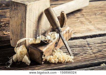 Wooden Hammer, Planer And Chisel On Wooden Table