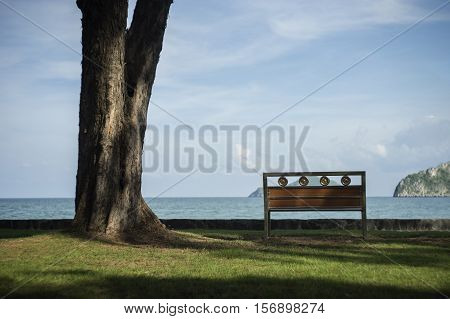 A Bench With Blurred Blue Sea And Sky In Background.secluded Place For Near The Sea Shore.lonely Con