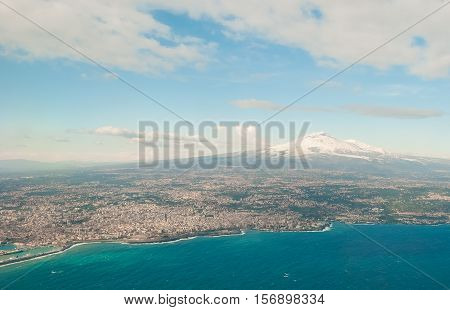 Aerial view of Catania and volcano Etna during the winter