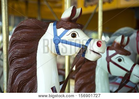 White horse with brown mane in a carousel