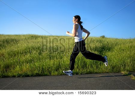 Woman running on a trail