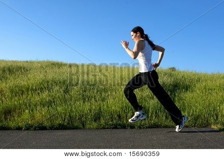 Woman sprinting on a trail