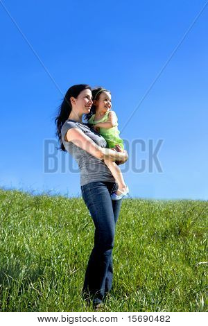 Mother and daughter in a meadow