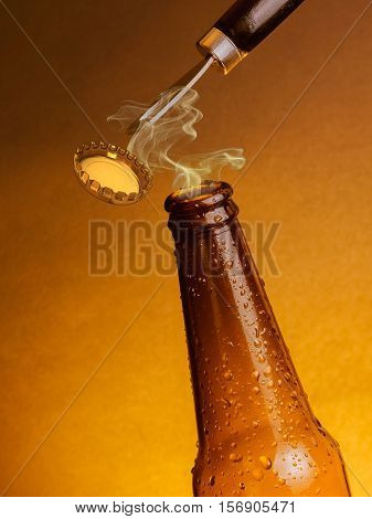 Man Open Fresh Cold Beer Ale Bottles With Drops And Stopper Open With Bottle Opener
