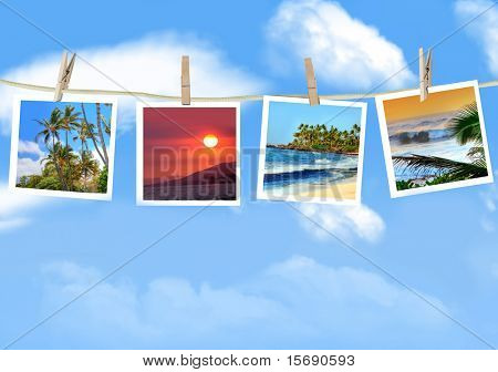 Travel photos hanging on a clothes line against a blue sky