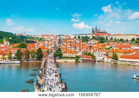 Panorama of the old part of Prague from the Old Town Bridge Tower. Beautiful view on the bridge over the river Vltava, district Hradcany and Prague Castle. Old Town architecture, Czech Republic.