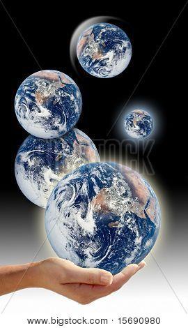Hand holding multiple Earths