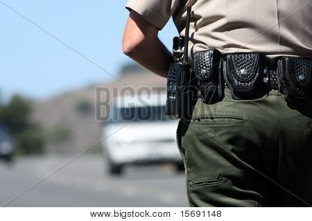 A police officer watching traffic