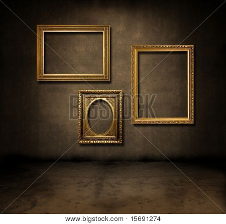 A dark, grungy room with gold frames on the wall