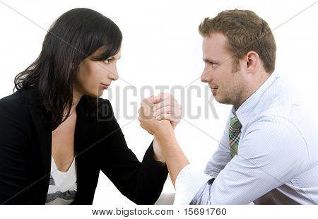 Business professionals arm wrestling