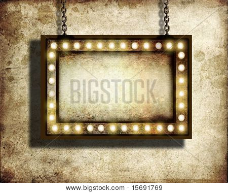 A grungy sign with marquee lights with room for copy